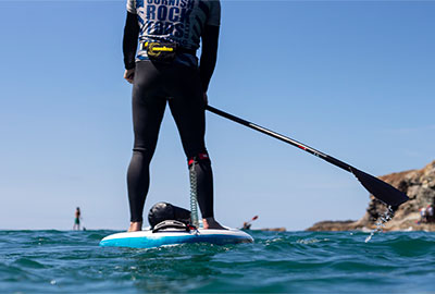 sea level view of cornish rock tors stand up paddleboard guide
