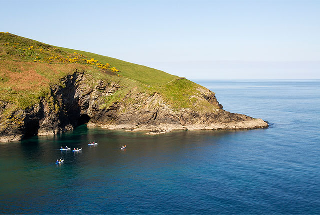 cornish rock tors sea kayaking group on a guided tour to port isaac, cornwall