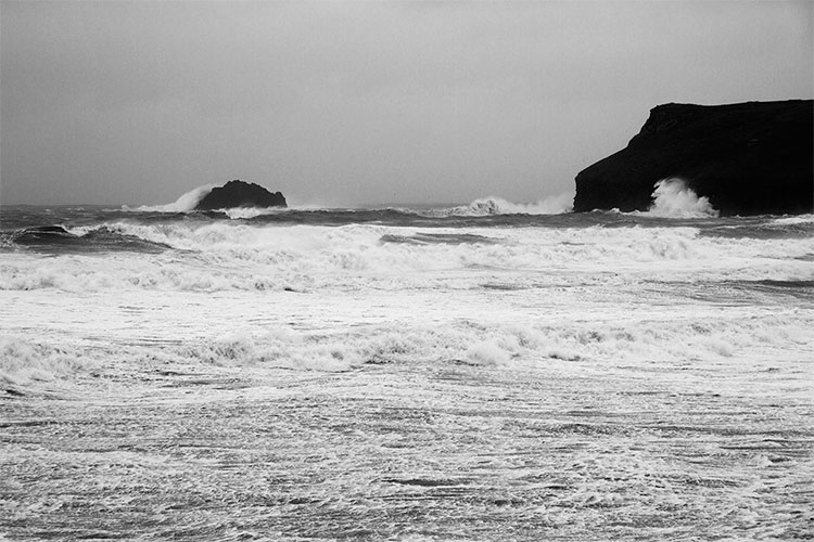storm waves battering pentire point, polzeath, in winter
