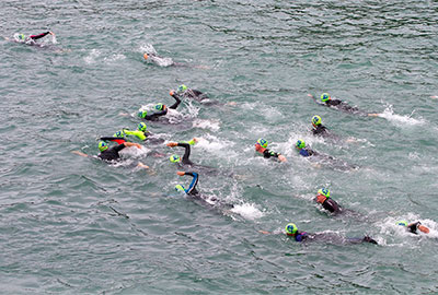 open water swimmers taking part in the big swim from port gaverne to port isaac