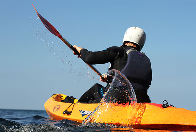 paddling a sea kayak