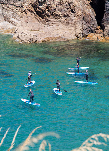 stand up paddleboard lesson in port gaverne, cornwall