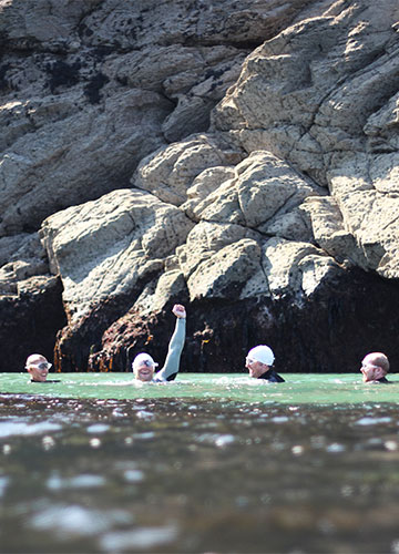 a group of swimmers a the end of an open water sea swim