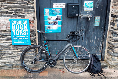 bike outside the cornish rock tors office in port gaverne