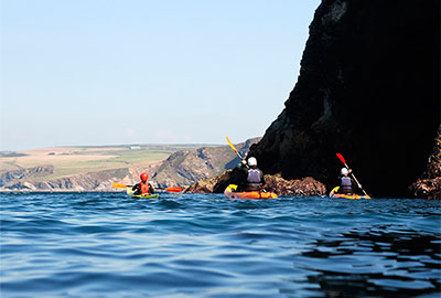 sea kayaking with cornish rock tors as part of the pedal and paddle offer