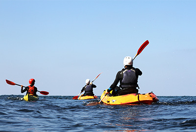 sea kayakers paddling at sea