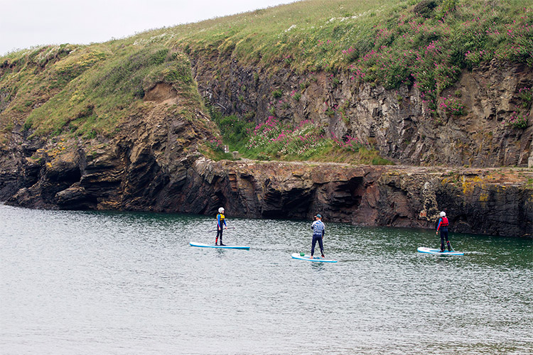 a stand-up paddleboarding lesson at port gaverne