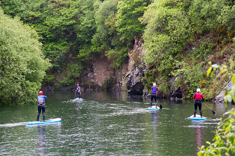 stand-up paddleboarding at tregildrans quarry lake in north cornwall