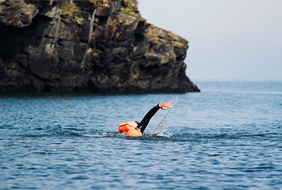 open water swimmer with tow float in cornwall