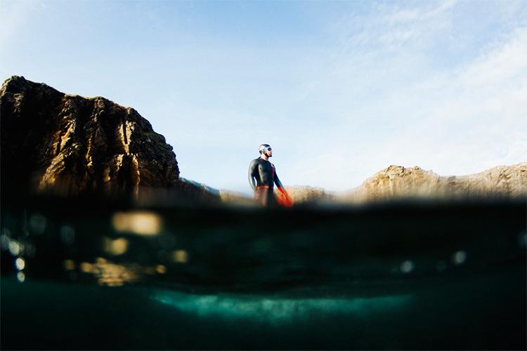 open water swim guide wearing swim research wetsuit