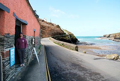 cornish rock tors managing director ben spicer standing outside their base at port gaverne, cornwall