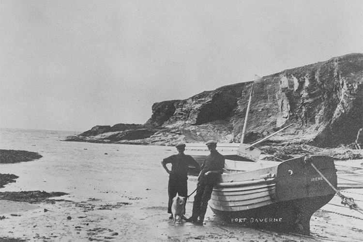 vintage photograph of local fishermen on the beach at port gaverne, cornwall