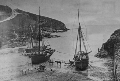 large ships for transporting slate from delabole quarry being loaded on the beach at port gaverne, cornwall