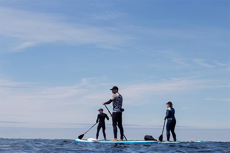 standup paddleboarding with cornish rock tors