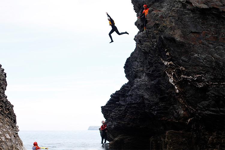 big jump during a coasteering activity in cornwall
