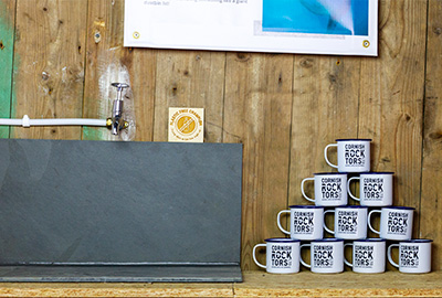 water refill station and cups at Cornish Rock Tors in Port Gaverne