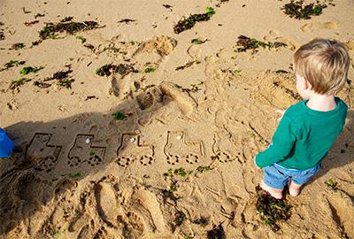 making art on the beach